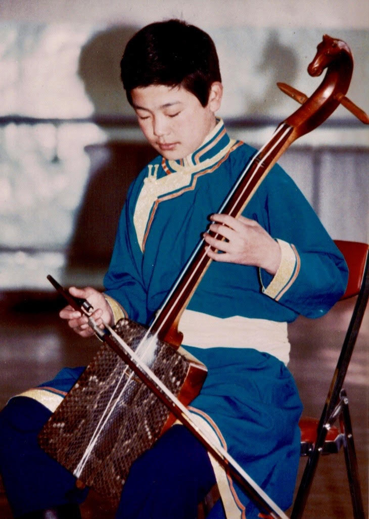 mongolian boy bow instrument