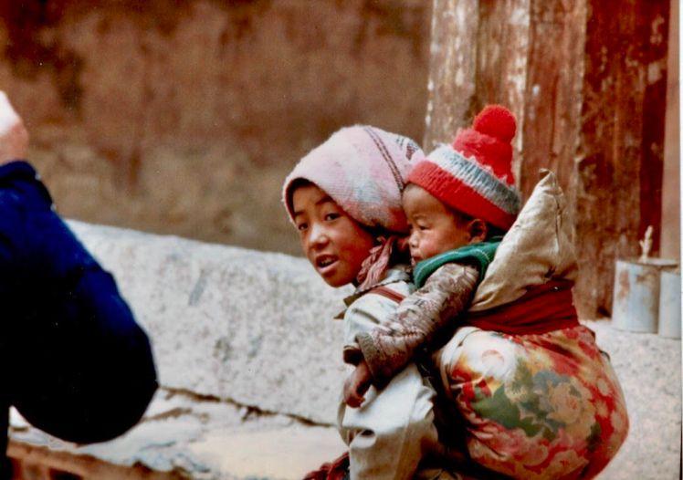 tibetan mom & backpack baby